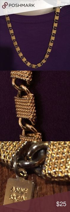 Vintage Anne Klein necklace in gold. A beautiful necklace in gold and it has a little weight to it. The clasp is a little unusual Jewelry Necklaces