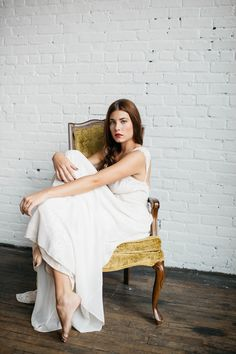 dreamy wedding shoot - vintage chair + white brick.