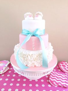 Coral and Teal ruffled baby shower cake, by Amy Hart