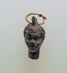 Gold earring with a pendant in the form of a youth with negroid features, Date 2nd–1st century B.C. Culture: Greek, Eastern Mediterranean