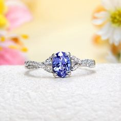 White Topaz, Tanzanite Ring push present - babys birthstone