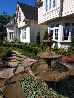 A pathway with water fountain.