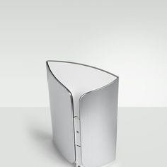 The wedge-shaped cabinet of the BeoLab 17 is made from a single piece of aluminum wrapped ...