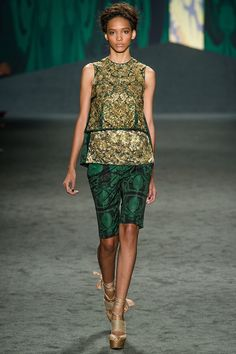 """""""Slim Bermuda shorts throughout."""" Vera Wang Spring 2013 RTW, gorgeous gold patterned fabric on the top, delicious against the emerald green"""