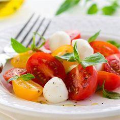 Mini Caprese Salad. Cherry Tomatoes, Basil and Mozzarella.