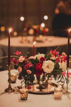Festive red floral centerpiece: http://www.stylemepretty.com/new-york-weddings/new-york-city/2014/09/23/nyc-winter-wedding-at-the-foundry/ | Photography: Les Loups - http://www.lesloupspicturesandsongs.com/:
