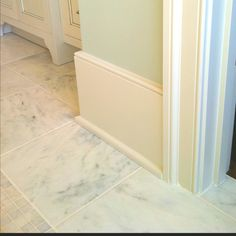 Baseboard trim and marble tile flooring