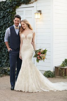 (sp) This beaded wedding gown featuring lace and silk chiffon over satin from Martina Liana is a visual masterpiece with its flirty low-cut V-neckline and illusion-tulle keyhole back. Beautiful buttons cover an easy-to-close zipper. The skirt falls freely into a scalloped lace train.