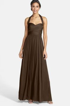 Embrace earth tones with these chocolate halter bridesmaid dresses. See more stunning styles here: http://www.mywedding.com/articles/brown-bridesmaid-dresses/