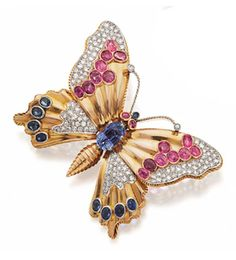 18 KARAT GOLD, BLUE AND PINK SAPPHIRE AND DIAMOND BUTTERFLY BROOCH, FRENCH, CIRCA 1945.  Mounted en tremblant, the body and wings set with numerous oval and cushion-shaped blue and pink sapphires and 1 pear-shaped sapphire, further decorated with panels of pavé-set single-cut diamonds weighing approximately 1.50 carats, assay marks.