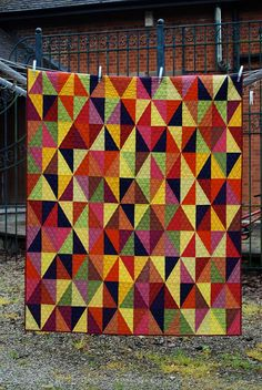 Harlequin quilt by Lynne @ Lilys Quilts - She provides details about how she straight line quilts. Good info.