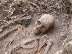 Saxon warrior buried with tankard and spear head.