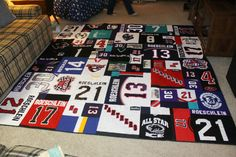 It's finished and it's awesome! This quilt was made for my nephew, Matt, from his hockey jerseys. He's played hockey from the youth leagues all the way through his senior year at North Central Hi…