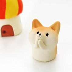 My name is Tetsuya Iseda. I live in Fukuoka, Japan. After graduating from Saga Prefectural Arita ceramics University I started making dog figurines from ceramic.