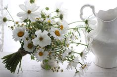 pretty bouquet 2 - love the different flowers with the same colors, set with the white china