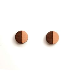 Turpentine Josephine Small Walnut & Brushed Copper Earrings: These little Josephine Walnut & Brushed Copper Earrings are part of a brand new mixed material jewellery collection designed in-house by Jude de Berker and exclusive to the Turpentine.  Inspired by time spent in her dad's carpentry workshop as a child and her training as a jeweller at Central Saint Martins the range mixes solid walnut wood with brushed steel, copper, brass and 100% solid silver earrings backs and findings.  The…