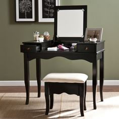 Get ready in your own personal area with this graceful Upton Home vanity and matching bench. Store makeup and other items in the two drawers while arranging necessities on top for a sleek and organized display, and close mirror for quick clean up