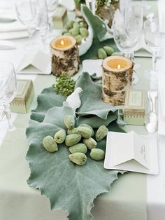 Bride Kelly d'Halluin's stylistic touches were evident in every detail. Here birch-bark vessels and porcelain doves adorn the table. - Veranda.com