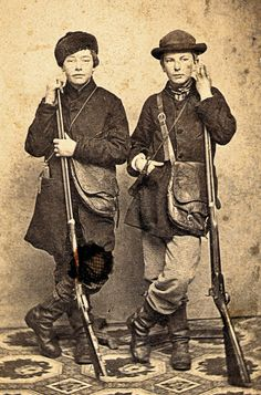 Striking a jaunty pose in this circa 1865-70 carte de visite, these lads wear leather game bags and hold half-stocked percussion sporting rifles. Rifle at left—fitted with double set triggers—appears to be a comparatively fancy specimen for a youth.  – Courtesy Dickinson Research Center, National Cowboy & Western Heritage Museum, 2003.196 –