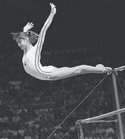 """Nadia, 1976 ... 10. And the beginning of the """"flying"""" uneven bar routine."""