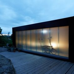 The small structure consists of a studio space, an LED bulb, and a translucent west wall for outdoor lighting. Element Lighting, Outdoor Lighting, Outdoor Decor, Copperhill Mountain Lodge, Outside Lamps, Tongue And Groove Panelling, Polycarbonate Panels, Real Fire, Exterior Cladding