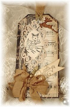 Distressed Vintage Tag...with sheet music, reindeer & gold bow.