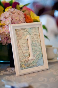 Love this idea for a table number- places that are meaningful to the couple- so sweet and full of personality!