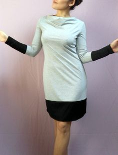 Pattern for Jersey dress. It is also suitable for knit fabrics. Details: Slim it, waterfall neckline, long sleeve with or without color combination possible if desired, rounded hem ... It is a multiple size Pattern with step by step pictorial sewing instruction in german and english. Two...
