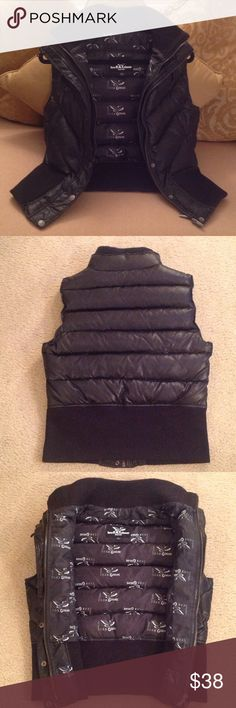 🍃🌹Triple F.A.T. Goose -  Goose Feather Vest The Authentic Brand 'Triple F.A.T. Goose Vest. Size Large but this one runs small. Fits more of a Small or Medium. Deep Rich Black Puffer style. It's 42% Goose Down / 58% Goose Feathers. Zips up Twice in the front. Also has Snaps and Loop closures. Please see all pictures. Excellent Condition 🍃🌹 Triple FAT Goose Jackets & Coats Vests