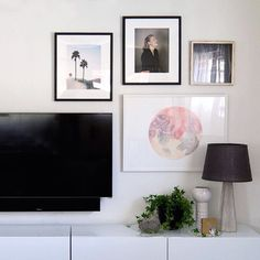 If you've ever wondered how to build a gallery wall around a tv look no further! @citysage's new collection is stunning!  #framebridge #regram by framebridge