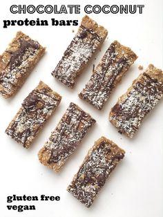 six ingredient protein bars: gluten free oats, almond butter, maple syrup, protein powder, dark chocolate, coconut flakes. Vegan, gluten free, and paleo friendly!
