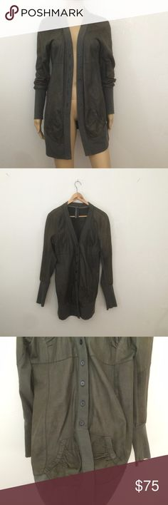 """RARE Leather Cardigan Olive Large Long Cardigan One of a kind piece! This has all the elements of a long cardigan. It has sweater buttons and opens up in the middle. It also has elastic cuffs, hem, and pockets. gorgeous olive green leather!   This is totally wearable in today's fashion.   Listed as size large. Please see measurements of the cardigan taken while buttoned up. It can be stretched a little, or kept open for the most flattering look. bust: 36"""" waist: 34"""" length: 29"""" sleeves…"""