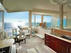 Lots of glass, great sunset and modern furniture and a living room to have them all