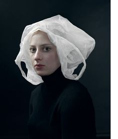 Hendrik Kerstens portraits with hats made of bags, bubble wrap and other materials.