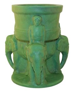 "Striking and very rare c.1907 Roseville Pottery Matte Green arts and crafts vase on an Egypto form with three men atop elephants. Great shape with super color. MINT CONDITION. No chips, cracks, damage or repair of any kind. Vase is 11"" tall and 10"" wide from elephant trunk to elephant trunk."