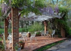 This arbor's support posts are wrapped with brick. What a great way to design an arbor to go with a brick house!