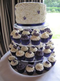 "Cadbury Purple and white wedding tower toped with an immense 8"" triple layered sponge cake."