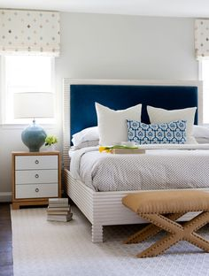 Chic bedroom features a white bed accented with a blue velvet headboard dressed in blue and gray bedding next to a two tone nightstand, Bungalow 5 Berkeley 3 Drawer Side Table, and a blue lamp alongside a burlap x stool with brass nailhead trim. Transitional Living Rooms, Transitional Decor, Transitional Kitchen, Blue Headboard, Velvet Headboard, Coastal Bedrooms, Bedroom Modern, Bedroom Classic, Classic Interior