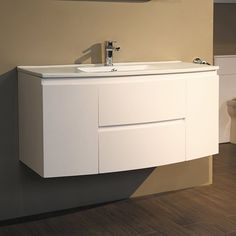 The Voss™ 1010 wall mounted vanity basin unit. A beautifully crafted bow front vanity unit with matching inset basin. 2 storage units either side of 2 spacious drawers provides plenty of storage and the stylish design makes this vanity unit the perfect