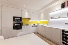 White+kitchen+with+yellow+splashbacks