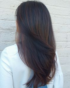 Purple, red violet, and copper sombre tones and long hair long layers haircut by…