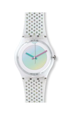 Spot-on style. The iconic WHITE RAVE watch is set apart with a white dial accented with iridescent foil. Features a transparent, shiny case. A woven strap stands out with Lurex dots to eye-catching effect. A shiny white buckle completes the design.  <br><strong>Model: </strong>Gent <br><strong>Dial: </strong>White with iridescent foil <br><strong>Case: </strong>Transparent shiny clear plastic <br><strong>Bracelet: </strong> White fabric with woven Lurex dots and loop and solid white shiny…