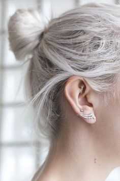 White hair in a partial ponytail.