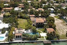   Matt Damon's Miami Waterfront Home   An aerial view of mega star Matt Damon's 12,705-square-foot home in Miami Beach, replete with pools, palms, and plenty of privacy.
