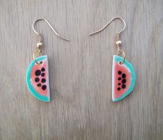 Those are fun watermelon dangle earrings. The materials are brass hooks, and handmade glazed ceramic watermelons.    This item is ready to ship