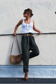 White tank with loose green pants + leather accessories.
