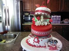 Chocolate cake with chocolate buttercream filling. Hand made gumpaste flowers. Cake was made for a womens 80 th. Betty boop themed birthday party.