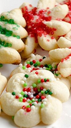 Holiday Cookie Spritz Cookies These spritz cookies are tiny and festive and, best of all, super easy to make! After the dough is decorated, the cookies bake in just six minutes. Christmas Cookie Exchange, Christmas Sweets, Christmas Cooking, Noel Christmas, Christmas Goodies, Christmas Ideas, Christmas Gifts, Yummy Cookies, Holiday Cookies