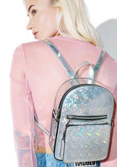 Current Mood Sparkle Party Mini Backpack looks like an explosion of shimmer confetti. Letz get this party started wit this structured mini backpack that's completely covered in a fab holographic prism coating that catches lights. YAS! Featuring a roomy interior lined in satin, front pockets, dual adjustable straps and top zipper closure, this lil hologram mini backpack is ready to rage.