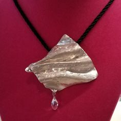 Texture, fold formed Sterling silver  pendant